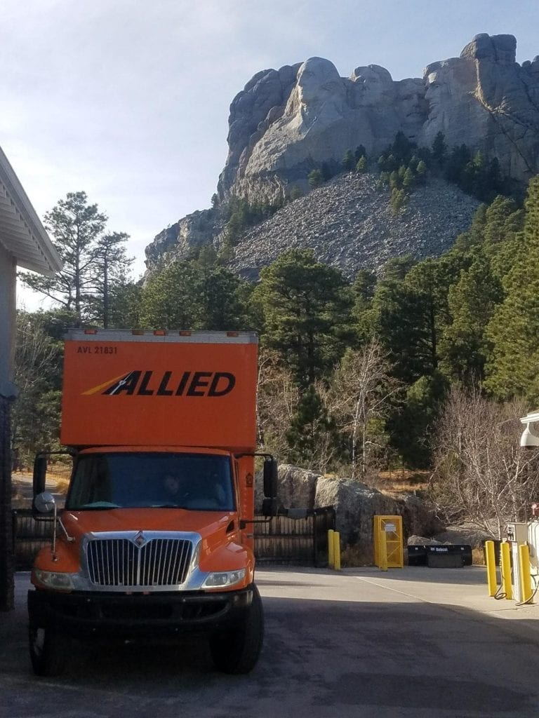 Moving Truck with Mount Rushmore in Background