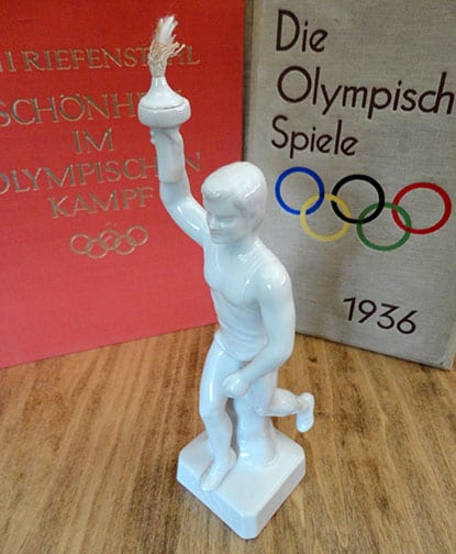 OLYMPIC GAMES PORCELAIN TORCH-BEARER STATUE
