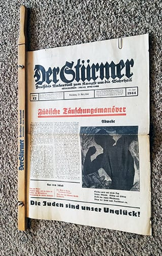 "NEWSPAPER HOLDER WITH LATE WAR 1944 ISSUE OF THE ANTI-SEMITIC PERIODICAL ""DER STÜRMER"""